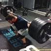 Strongman Athlete performing heavy squats in in No89 Men Bodybuilding Shorts