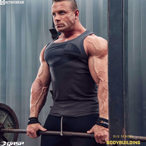 MGactivewear Bodybuilding Athlete working out in Men Muscle Tank Top.